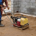 Трамбовка бетонного пола по грунту